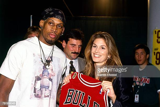 Supermodel Cindy Crawford poses with Dennis Rodman the Chicago Bulls before Game 3 of the 1996 NBA Finals on June 9 1996 at the Key Arena in Seattle...