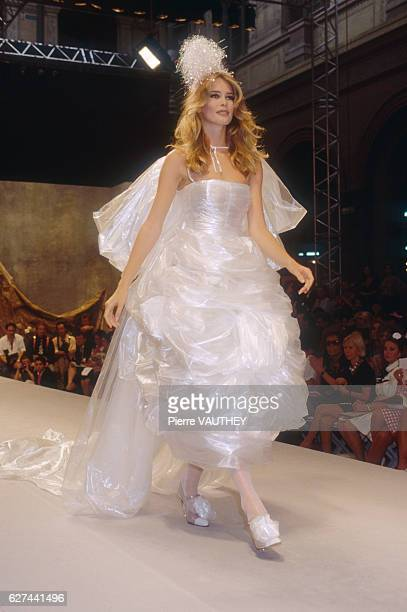Supermodel Claudia Schiffer models a women's haute couture wedding dress by German fashion designer Karl Lagerfeld for French fashion house Chanel at...