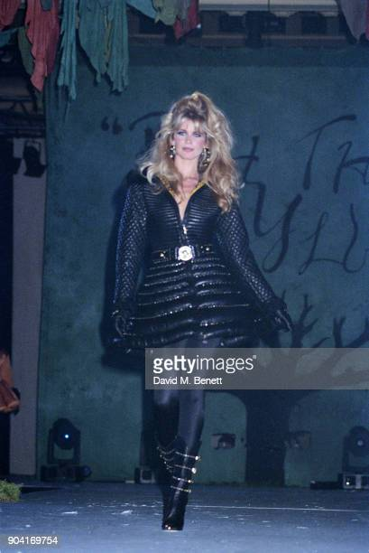 Supermodel Claudia Schiffer wearing black bomber coat by Versace at the 'The Rhythm of Life' Fashion Ball organised by the Rainforest Foundation at...