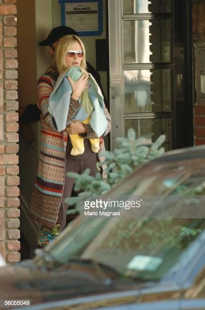 Supermodel entrepreneur Heidi Klum exits her residence with her baby son Henry on November 1 2005 in New York City Baby Henry was born on September...
