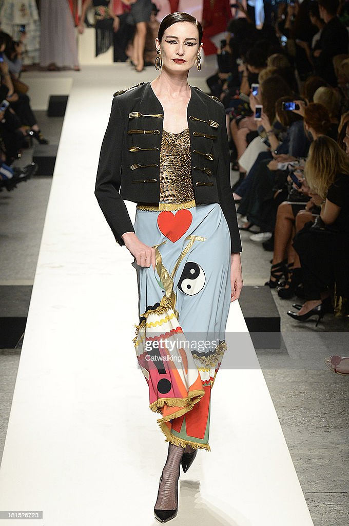 Supermodel Erin O'Connor walks the runway at the Moschino anniversary event and Spring Spring Summer 2014 fashion show during Milan Fashion Week on September 21, 2013 in Milan, Italy.