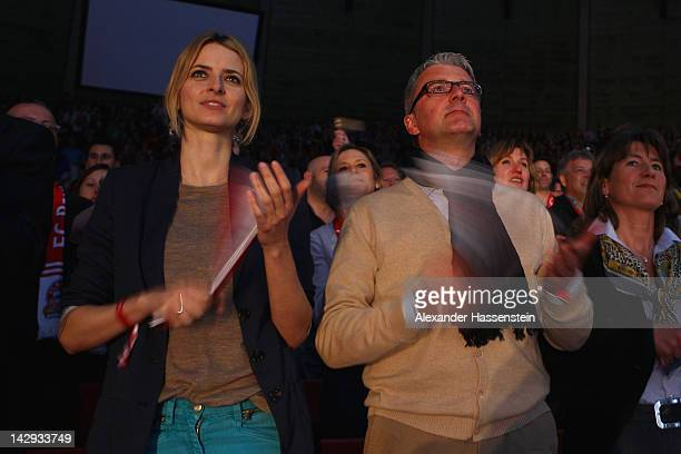 Supermodel Eva Padberg attends with Audi CEO Rupert Stadler during the Beko Basketball match between FC Bayern Muenchen and Brose Baskets Bamberg at...