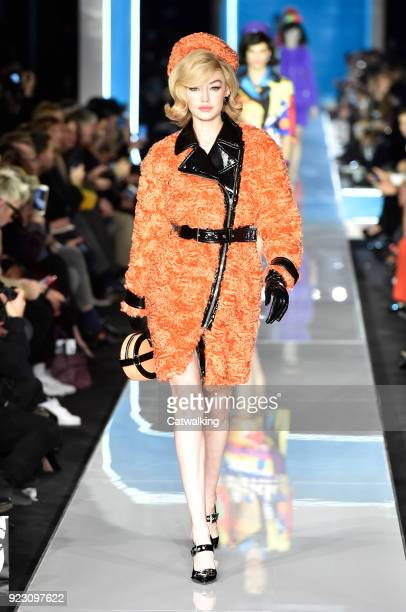 Supermodel Gigi Hadid walks the runway at the Moschino Autumn Winter 2018 fashion show during Milan Fashion Week on February 21 2018 in Milan Italy