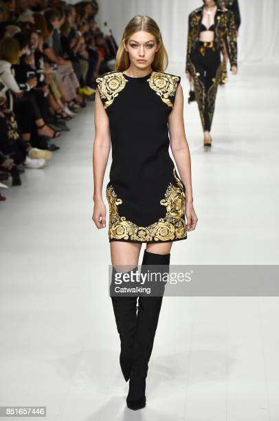 Supermodel Gigi Hadid walks the runway at the Versace Spring Summer 2018 fashion show during Milan Fashion Week on September 22, 2017 in Milan, Italy.