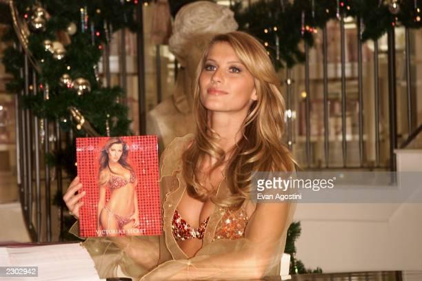 Supermodel Gisele Bundchen showsoff the $15 million 'Fantasy Bra' at the grand opening of Victoria's Secret Lincoln Centerarea store on Broadway New...