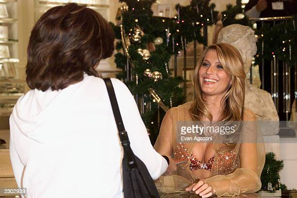 Supermodel Gisele Bundchen showsoff the $15 million 'Fantasy Bra' signs photo's for fans at the grand opening of Victoria's Secret Lincoln Centerarea...
