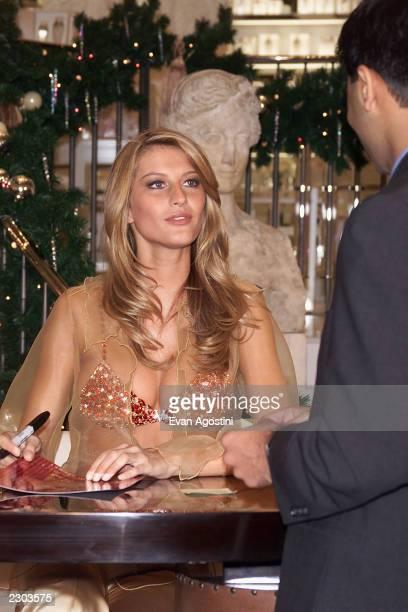 Supermodel Gisele Bundchen showsoff the $15 million 'Fantasy Bra' signs photo's for fans at the grand opening of Victoria's Secret Lincoln Centerarea...