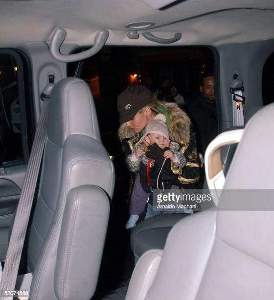 Supermodel Heidi Klum carries her daughter Leni at JFK Airport on January 16 2005 in New York City