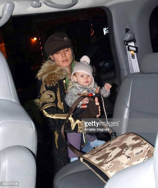 Supermodel Heidi Klum carries her daughter Leni at JFK Airport on January 16 2005 in New York City