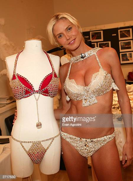 Supermodel Heidi Klum posing along side the $11 million Fantasy Bra at a fitting for the Victoria's Secret 2003 Fashion Show at the Victoria's Secret...