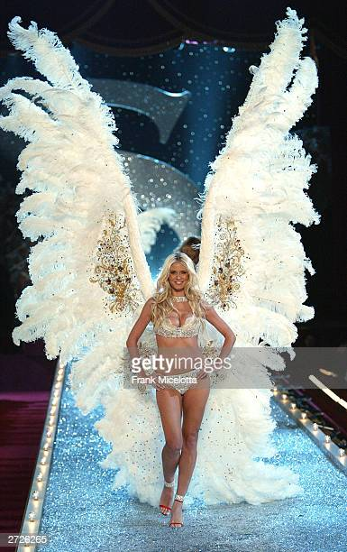 Supermodel Heidi Klum walks the runway at the Victoria's Secret Fashion Show at the 69th Regiment Armory November 13 2003 in New York City The...