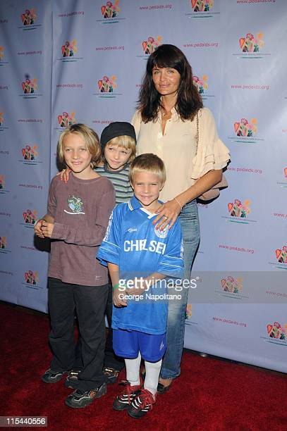 Supermodel Helena Christensen along with her children attend the 'Kids for Kids' celebrity carnival at the Park Avenue Armory on September 20 2008 in...