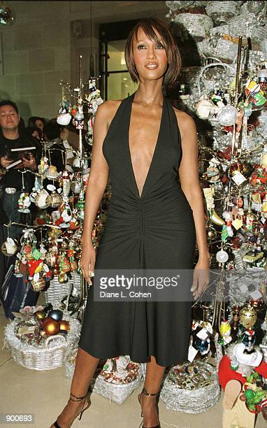 Supermodel Iman who is also David Bowie's wife makes an appearance November 20 2001 at Henri Bendel in New York City to promote her new book I Am Iman