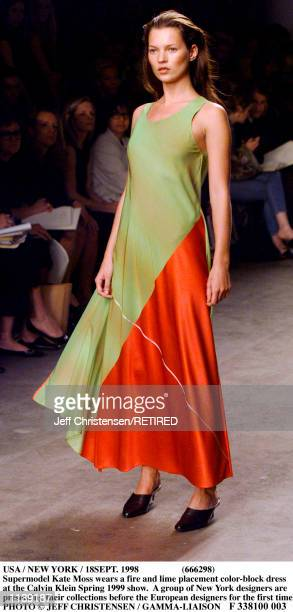 Supermodel Kate Moss wears a fire and lime placement color-block dress at the Calvin Klein Spring 1999 show in New York September 18. A group of New...
