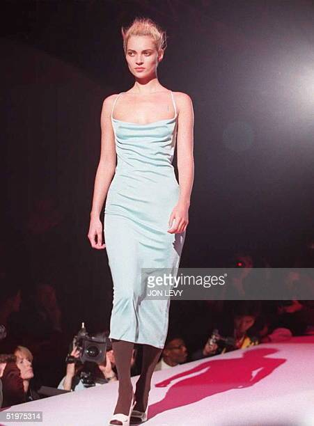 Supermodel Kate Moss wears a turquoise dress in the showing of the Gianni Versace Fall 1996 fashions 26 March in New York. New York fashion week...