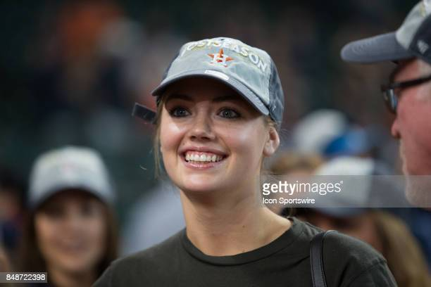 Supermodel Kate Upton waits for Houston Astros starting pitcher Justin Verlander on the field after clinching the Central Division after an MLB game...