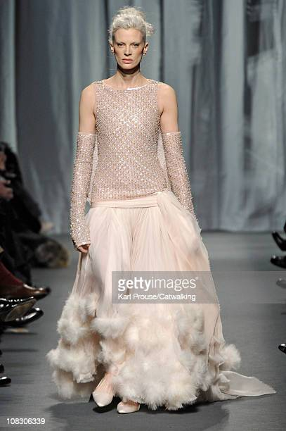 Supermodel Kristen McMenamy walks the runway at the Chanel fashion show during Paris Haute Couture Fashion Week on January 25 2011 in Paris France