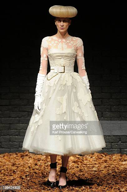 Supermodel Kristen McMenamy walks the runway to close the presentation at the McQ Autumn Winter 2012 fashion show during London Fashion Week on...