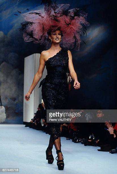 Supermodel Linda Evangelista wears a one-shouldered, black haute couture cocktail dress by German designer Karl Lagerfeld for French fashion house...