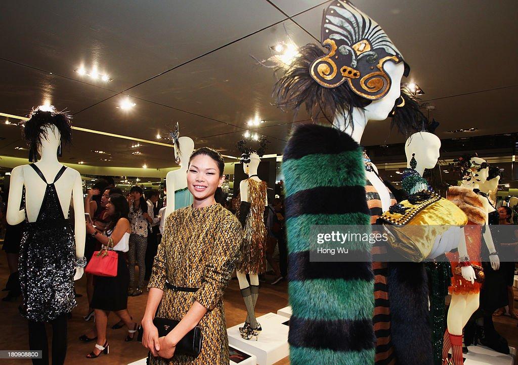 Supermodel Lv Yan attends Miuccia Prada and Catherine Martin Dress Gatsby Exhibition in Prada store on September 10, 2013 in Shanghai, China.