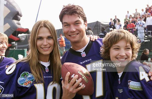 Supermodel Molly Sims actor Jerry O'Connell and 'Survivor' Colleen Haskell pose for a photo before MTV's 'Rock 'N Jock' in the NFL Experience at...