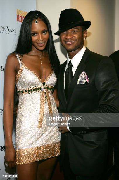 Supermodel Naomi Campbell and singer Usher pose backstage at the Fashion Rocks concert held at Radio City Music Hall on September 8 2004 in New York...