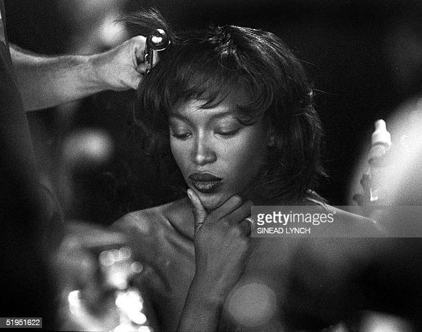 Supermodel Naomi Campbell has her hair done backstage at Matthew Williamson's Spring/Summer 2000 show in which she was starring 22 September 1999....
