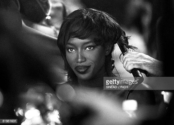 Supermodel Naomi Campbell has her hair done backstage at Matthew Williamson' s Spring/Summer 2000 show in which she was starring 22 September 1999...