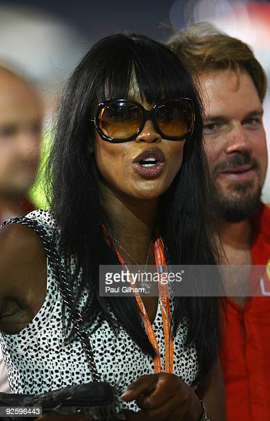 Supermodel Naomi Campbell is seen in the pitlane during the Abu Dhabi Formula One Grand Prix at the Yas Marina Circuit on November 1, 2009 in Abu...