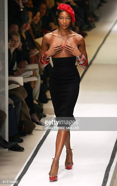 Supermodel Naomi Campbell presents a creation for Jean-Paul Gaultier 20 January 2002 during the spring/summer 2002 haute couture collections in...