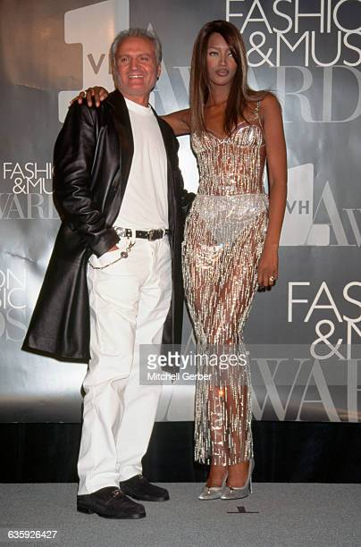 Supermodel Naomi Campbell puts her arm around designer Gianni Versace at the VH1 Fashion and Music Awards