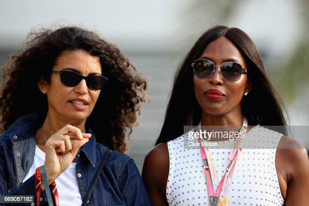 Supermodel Naomi Campbell walks in the Paddock with a friend during the Bahrain Formula One Grand Prix at Bahrain International Circuit on April 16...