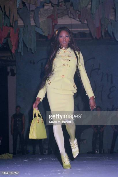 Supermodel Naomi Campbell wearing yellow suit tights shoes and handbag by Versace at the 'The Rhythm of Life' Fashion Ball organised by the...