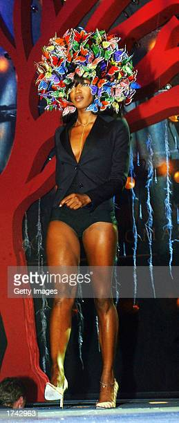 Supermodel Naomi Campbell wears an outfit by Philip Treacy at The Brown Thomas Fashion Show at The Point Theatre January 23 2003 in Dublin Ireland