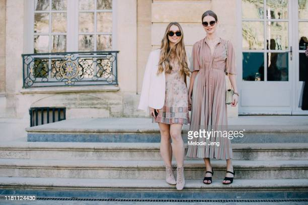 Supermodel Natalia Vodianova and her sister Kristina Kusakina in pink dior Dresses outside the Dior show during Paris Fashion Week Fall/Winter 2019...