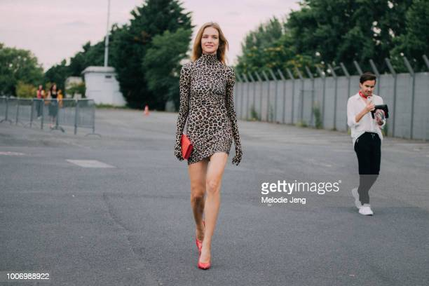 Supermodel Natalia Vodianova attends the Vetements show in a Vetements bodyfitting leopard print dress a red clutch and red heels during Couture...