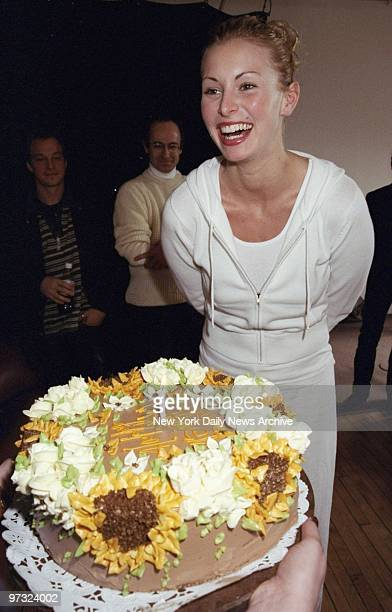 Supermodel Niki Taylor while shooting a poster for Cover Girl for the Special Olympics to be held in Raleigh NC is surprised with a birthday cake...