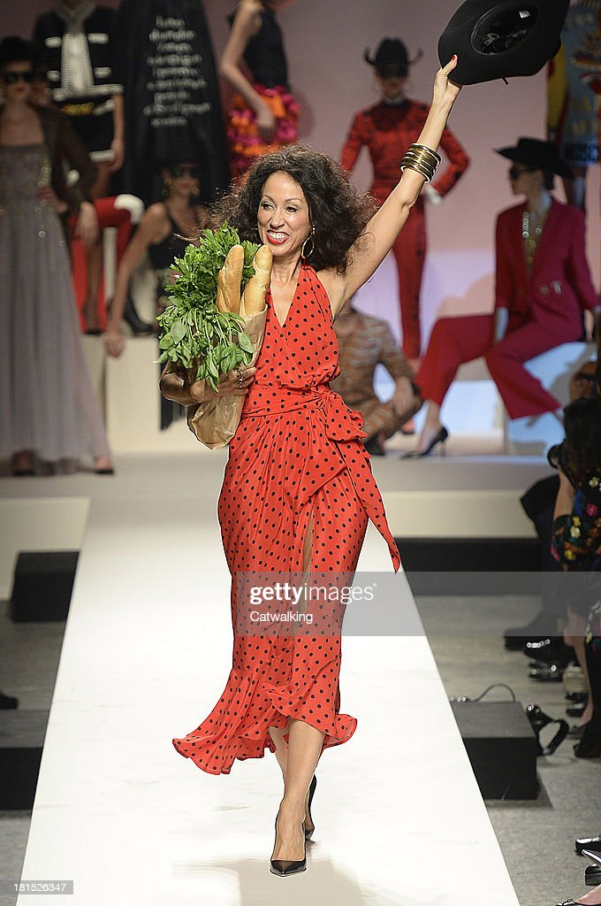 Supermodel Pat Cleveland walks the runway at the Moschino anniversary event and Spring Summer 2014 fashion show during Milan Fashion Week on September 21, 2013 in Milan, Italy.