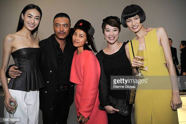 Supermodel Qin Shu Pei John Minh Nguyen Chen Man Candy Lee Wang Xiao pose for pictures during the Calvin Klein special dinner at the Long March Space...