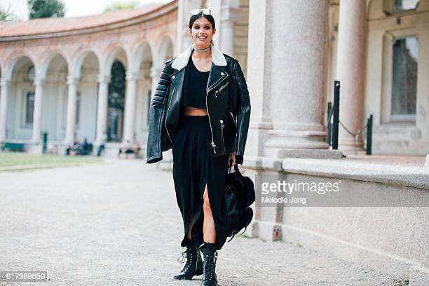 Supermodel Sara Sampaio wears an allblack outfit including Linda Farrow sunglasses a Philipp Plein jacket a croptop openleg trousers a Prada backpack...