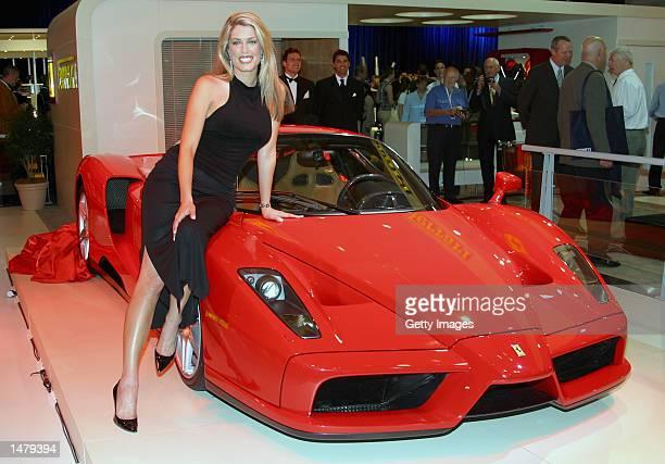 Supermodel Tara Moss poses on the bonnet of the new Ferrari Enzo at the Sydney International Motor Show on October 17 2002 in Sydney Australia More...