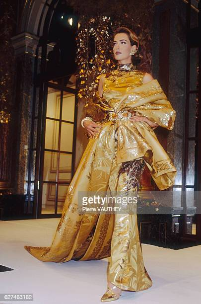 Supermodel Tatjana Patitz models a women's haute couture gold evening gown by Italian fashion designer Gianfranco Ferre for French fashion house...