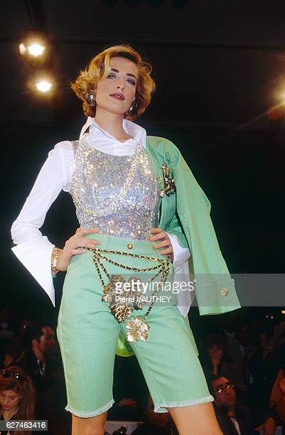 Supermodel Tatjana Patitz models a women's readytowear light green suit by German fashion designer Karl Lagerfeld for French fashion house Chanel at...