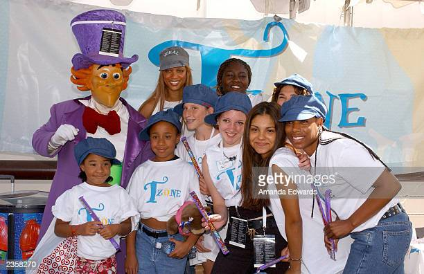 Supermodel Tyra Banks poses with Willy Wonka and a group of campers to promote T Zone on the roof of the carpark at the Glendale Galleria on August 2...