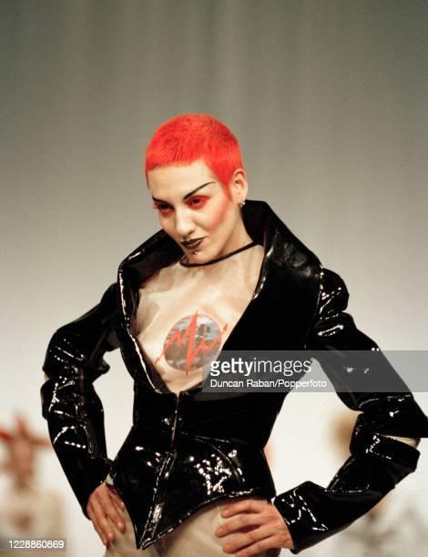 A supermodel walking on the catwalk in fashion designer Stella McCartney's Graduate Show in London England on 12 June 1995