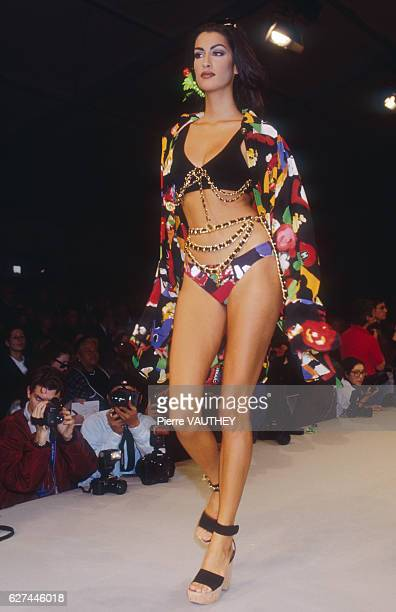 Supermodel Yasmeen Ghauri models a women's readytowear bikini and matching print jacket by German fashion designer Karl Lagerfeld for French fashion...