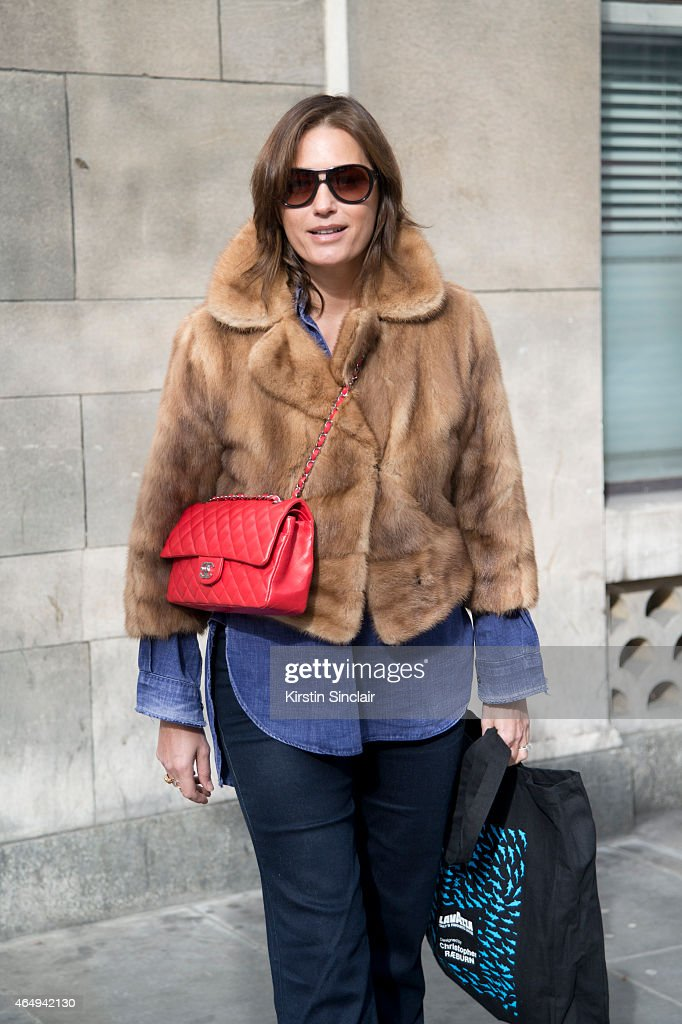 Supermodel Yasmin Le Bon wears a Vital jacket, Modeo workman shirt, Oakley sunglasses and a Chanel bag on February 24, 2015 in London, England.