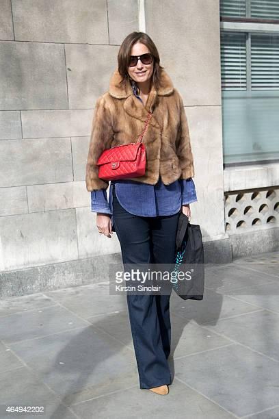Supermodel Yasmin Le Bon wears a Vital jacket Modeo workman shirt Oakley sunglasses and a Chanel bag on February 24 2015 in London England