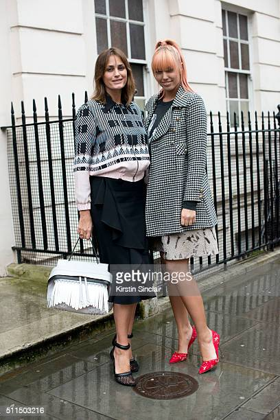 Supermodel Yasmin Le Bon who wears a Markus Lupfer top and trousers and Alexander Wang shoes with model Amber Le Bon who wears an Anna Sui coat...