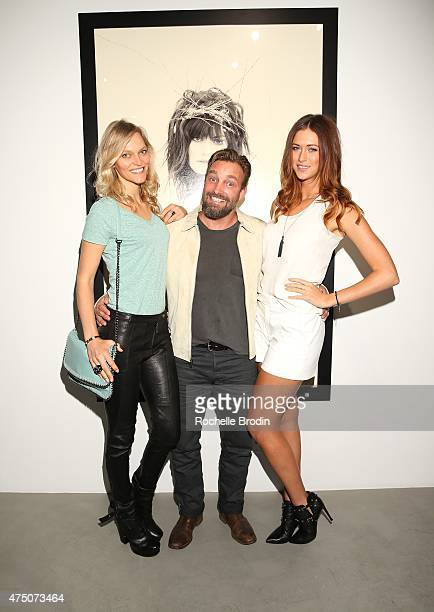 Supermodel/author Sarah DeAnna photographer/artist Brian Bowen Smith and jewelry designer Courtney Burton attend the 'Blue Nudes' exhibition at De Re...